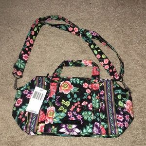 I am selling a Vera Bradley Iconic 100 hand bag.